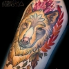 Melissa-Fusco-Golden-wolf-thigh-tattoo-denver-colorado-tattoo-artist-ruby-crystals