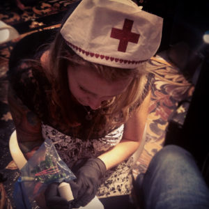 melissa fusco tattooing nurse hat